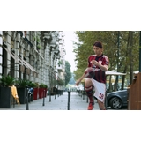 Milan footballers breeze through the city